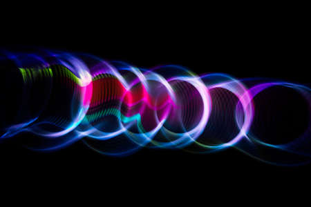 ripple effect: Sound waves in the visible blue color in the dark Stock Photo