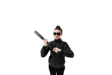 Portrait of an angry woman with a bat, isolated on white background. Serious and strict debt collector Stock Photo