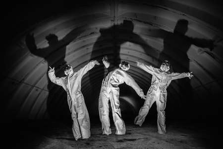 Ghosts in dark tunnel of nuclear power plant Stock Photo