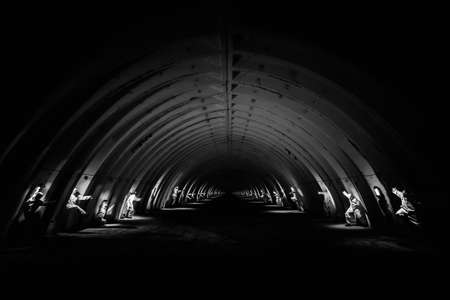 Ghosts in dark tunnel of nuclear power plant 免版税图像