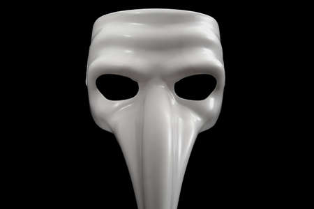 Mask with long nose is isolated on black Stock Photo