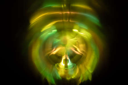 Yoga meditation in lotus pose with aura spiritual. Abstract blurred background