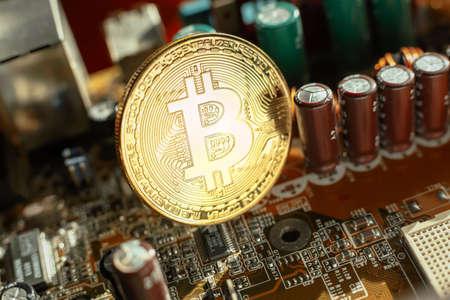 Electronic circuit blur. Bitcoin coin on electronic board Stok Fotoğraf