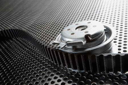 Bearing tensioner and timing belt on a metal surface Stok Fotoğraf