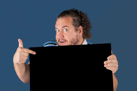 Fat funny man holding a black writing board