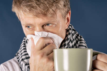 Adult man patient with cold and flu illness relief Reklamní fotografie