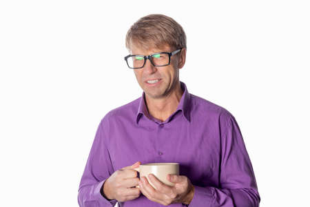 Handsome middle age man with cup of coffee isolated