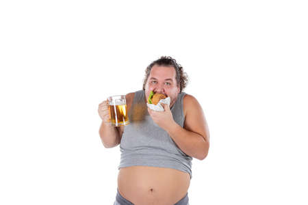 Funny fat man eating burger and drinking alcohol beverage