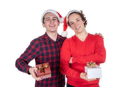 Two funny young men celebrating christmas isolated