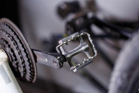 Black metal pedal on a bike with hard light. Bike accessories