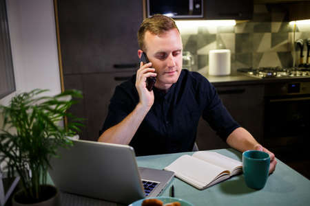 businessman working with laptop, work from home, thoughtful and worried about the future, talking on the phone, stock market trends, messages, virus quarantine time
