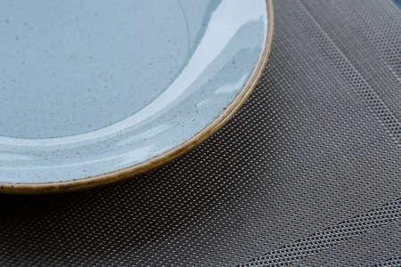 Empty plate of blue glaze ceramic melamine for dinner.