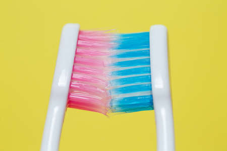 Two toothbrushes pink and blue. Toothbrush concept for a couple, living together as the beginning of a family