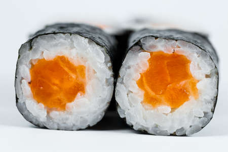 Rolls with red fish, fresh rice with salmon wrapped in nori.