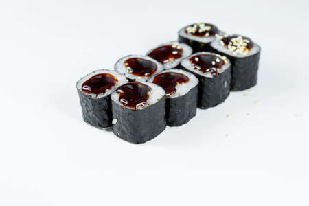 Japanese traditional food. Sushi rolls with fresh tuna avocado and cream cheese and soy sauce