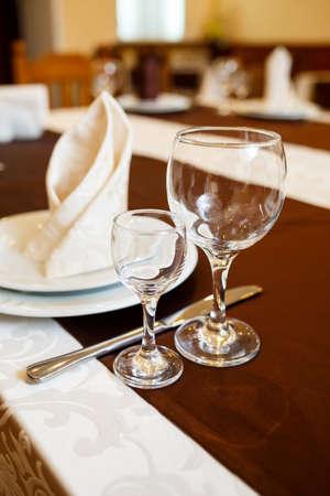Table setting in a restaurant. Glass, plate, fork, knife