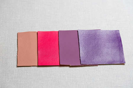square pieces of multi-colored fabric laid out on a gray background