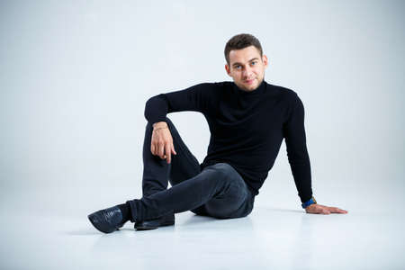 young businessman in black golf and jeans Stockfoto