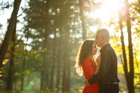Beautiful couple in the autumn forest
