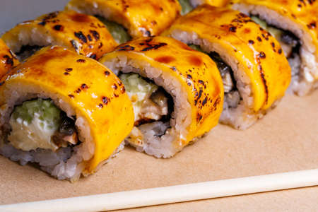A set of sushi from many types of roles and with different stuffing. Sushi menu. Japanese gourmet sushi.
