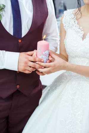 bride and groom lighting a candle together Standard-Bild