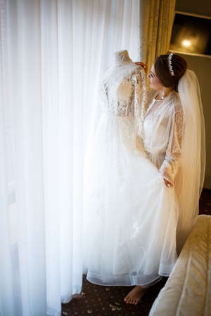 bride dresses her white wedding dress