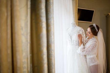 bride dresses her white wedding dress