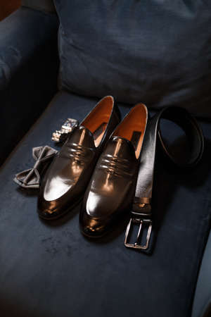 Morning details of a stylish groom with leather shoes