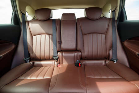Brown leather seats in the new car. Interior upholstery with genuine leather.