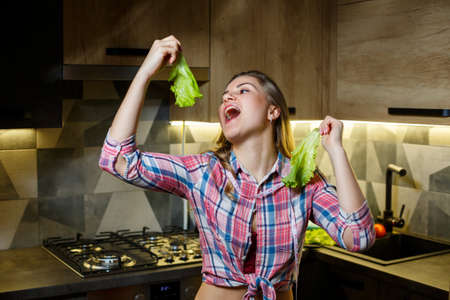 Girl with beautiful figure holds vegetables Standard-Bild