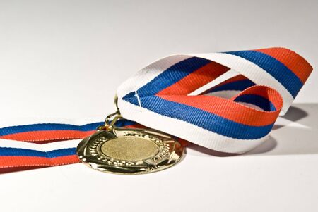 tricolour: Studio close-up photo of golden medal with tricolour ribbon isolated on white background