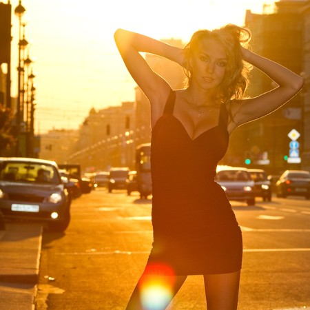 young sexy gorgeous fashionable woman standing and posing at city street in sunset back light Stock Photo - 7487785