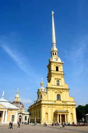 bilding: Cathedral and square in Peter and Paul fortress on a sunny day. The highest bilding in Saint Petersburg.