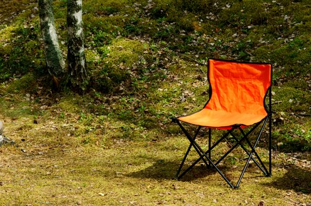 camping life. camp chair standing outdoors photo