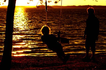 adult family couple have fun at the beach at sunset time photo