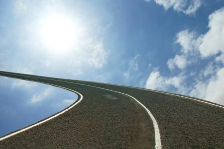 asphalt speedway over blue sky background