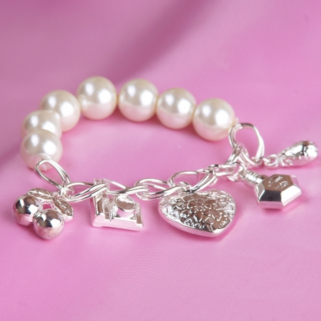 pearl bracelet on pink silk background photo