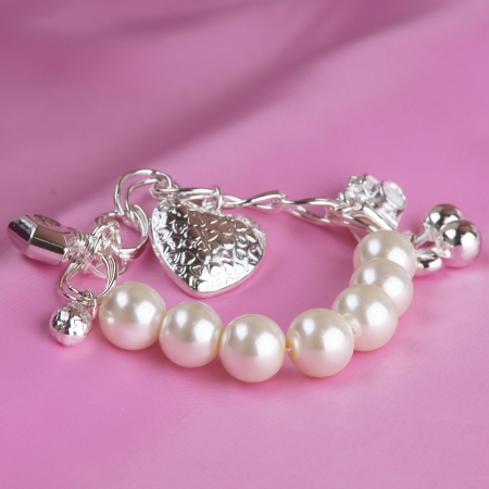 silver jewelry: pearl bracelet on pink silk background Stock Photo