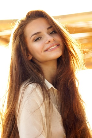 tender outdoor portrait of young attractive, tender, sensual and elegant woman 스톡 콘텐츠