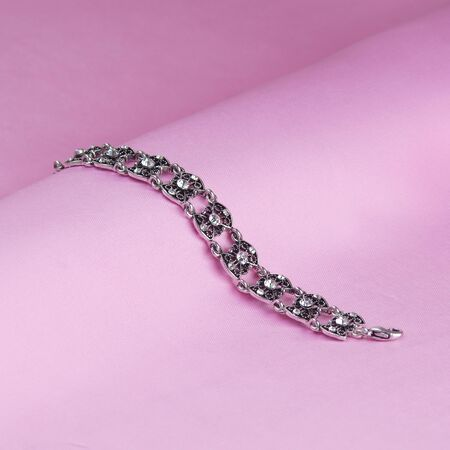 metal bracelet on pink silk background Stock Photo - 16164046