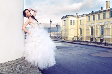 street fashion: outdoors portrait of young beautiful bride in city streets