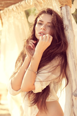 tender outdoor portrait of young attractive, tender, sensual and elegant woman photo