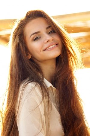 tender outdoor portrait of young attractive, tender, sensual and elegant woman Stockfoto
