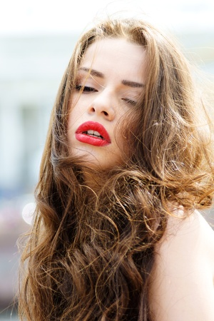 outdoor fashion portrait of young beautiful woman with long dair hair