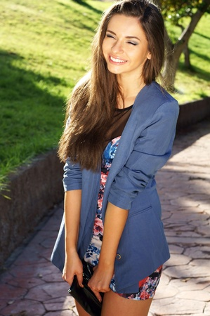 young beautiful girl smiling outdoors photo