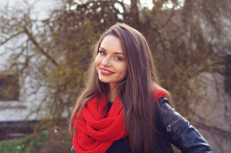 young beautiful girl in leather jacket smiling and looking in camera Stock Photo
