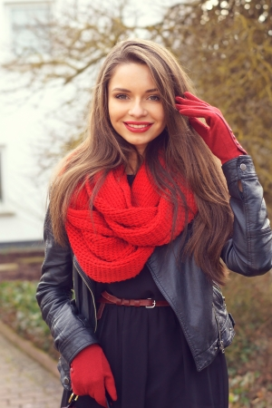 winter road: stylish smiling girl outdoor portrait