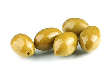 olive green: green olives in olive oil on white background         Stock Photo