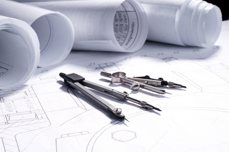 architecture plans: part of engineering project. rolls of blueprints and tools