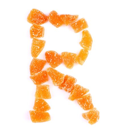 r sliced: letter R written with slices of dried sweet fruits
